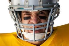 Portret agresywny futbolu amerykańskiego gracz jest ubranym hełm Obraz Royalty Free