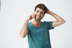 Portret atrakcyjny młody latynoski męski ono uśmiecha się w błękitnej koszula z piękną fryzurą, być nieśmiały podczas gdy opowiad zdjęcie royalty free