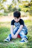 Portret azjatykcia śliczna chłopiec przy parkiem Obraz Royalty Free