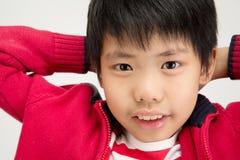 Portret azjatykcia śliczna chłopiec z uśmiech twarzą Obrazy Stock