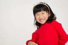 Portret azjatykcia śliczna dziewczyna z uśmiech twarzą Obrazy Stock