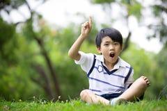 Portret azjatykcia chłopiec w parku troszkę obraz royalty free