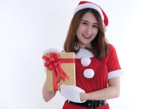 Portret azjatykcia kobieta w Santa Claus sukni na białym tle Fotografia Stock