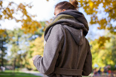 Portret of a beautiful young girl in park. Back view. Autumn tim Stock Image