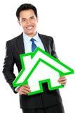 Portret biznesmena mienia domu znak Zdjęcia Royalty Free