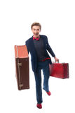 Portret biznesmena obsiadanie na jego walizce podczas gdy i uśmiech Obraz Royalty Free
