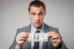 Portret biznesowego mężczyzna mienia pieniądze Zdjęcie Royalty Free