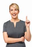 Portret bizneswoman Wskazuje Up Z pomysłem Zdjęcie Stock