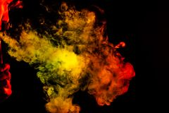 Portret boczna usta część faceci stawia czoło z barwionym backlight dymi vape i exhaling monochrom białego kolor żółtego i czerwi zdjęcie stock