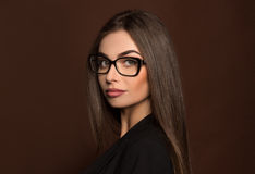 Portret business woman in glasses and a black suit Royalty Free Stock Photo