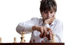 Portret chłopiec bawić się szachy Zdjęcie Royalty Free