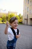 Portret chłopiec ono uśmiecha się i bieg Obraz Stock