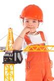 Portret chłopiec w pomarańczowym hełmie, izolacja zdjęcie royalty free
