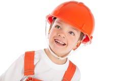 Portret chłopiec w pomarańczowym hełmie, izolacja Obrazy Royalty Free
