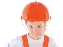 Portret chłopiec w pomarańczowym hełmie, izolacja Zdjęcie Stock