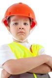 Portret chłopiec w pomarańczowym hełmie, izolacja fotografia royalty free