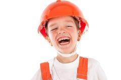 Portret chłopiec w pomarańczowym hełmie, odosobnienie zdjęcie stock