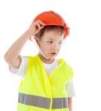 Portret chłopiec w pomarańczowym hełmie, odosobnienie obraz royalty free
