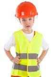 Portret chłopiec w pomarańczowym hełmie, odosobnienie fotografia royalty free