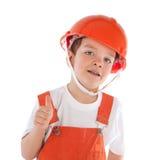 Portret chłopiec w pomarańczowym hełmie, odosobnienie obrazy stock