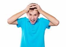 Portret chłopiec wskazuje palec pokazuje emocje ekspresyjne na białym tle z błękitną koszula Obraz Stock