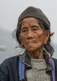 Portret Close up of Hmong elderly woman against gray skies. TA VAN, VIETNAM - CIRCA MARCH 2012: Portret Close up of Hmong elderly woman against gray skies Stock Images