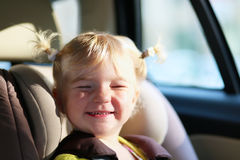 Portret of cute preschooler girl in the car Royalty Free Stock Images