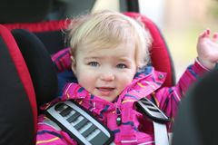 Portret of cute preschooler girl in the car Stock Photos