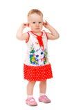 Portret dat van babymeisje haar oren houdt Stock Foto's