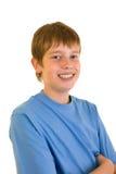 Portret del estudiante sonriente sobre blanco Imagenes de archivo