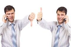 Portret dwa biznesmena z kciukami w górę i na dół zdjęcie royalty free