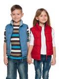 Dwa rozochoconego dziecka na białym tle fotografia royalty free