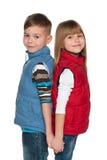 Dwa uśmiechniętego dziecka na białym tle zdjęcia royalty free