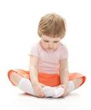 Portret dziecka obsiadanie na podłoga zdjęcia royalty free