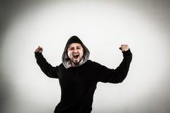 Portret energiczny faceta raper na lekkim tle fotografia royalty free