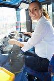 Portret Żeński kierowca autobusu Za kołem Zdjęcia Royalty Free
