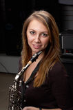 Portret of female playing on  saxophone Royalty Free Stock Photo