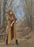 Portret fotografia jest ubranym futerko wzorcowa dziewczyna odziewa w natury wiosny tle Zdjęcie Royalty Free