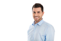 Portret: Geïsoleerde knappe glimlachende bedrijfsmens over wit