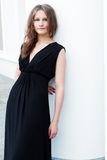 Girl in a long black dress Stock Image