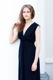 Girl in a long black dress Stock Photography