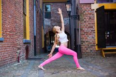 Portret girl Morning yoga in city stock images