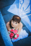 Portret of happy bride in white dress on stairs Stock Images