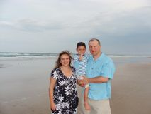 Family at the beach Stock Photos