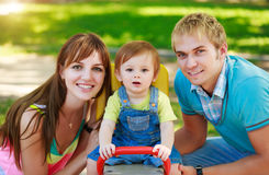 Portret of happy family in a summer park Stock Photos