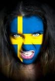 Portret kobieta z flaga Szwecja malował na jej f Zdjęcie Royalty Free