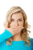 Portret kobieta zakrywa jej usta Zdjęcia Stock