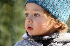 A portret of a little boy outside. Royalty Free Stock Photos