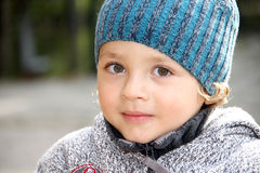 A portret of a little boy outside. Royalty Free Stock Image