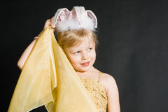 Portret of little girl. In yellow dress stock images